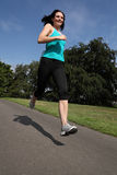 Summer exercise running outdoors for young woman Royalty Free Stock Image