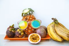 Summer exotic fruits as a background with fresh juicy ingredients - passion fruis, pineapple and mangosteen. stock photos