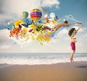 Summer explosion. Summer color explosion with jumping girl at the beach royalty free stock images
