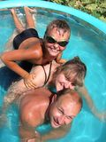 Summer Family Fun 2. Summer Family Fun in beautiful small pool Stock Photos