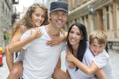 Summer family portrait of parents and kids outside Stock Photos