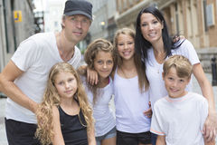 Summer family portrait of parents and kids outside Stock Image