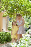 Summer family. Portraitof happy mother with daughter  having good time in summer environment Royalty Free Stock Photo