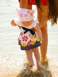 Mother playing with baby on beach Royalty Free Stock Photos