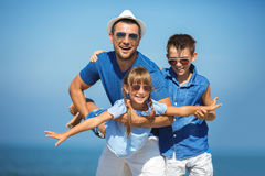 Summer, family, vacation concept. Father with children having fun.  Summer, family, vacation concept Stock Photo
