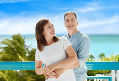 Summer family vacation. Happy middle aged couple having fun on travel holidays weekend. Sea and beach background. Copy space. Selective focus royalty free stock image