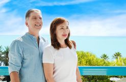 Summer family vacation. Happy middle aged couple having fun on travel holidays weekend. Sea and beach background. Copy space. Selective focus stock photo