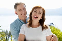 Summer family vacation. Happy middle aged couple having fun on travel holidays weekend. Sea and beach background. Copy space.  stock images