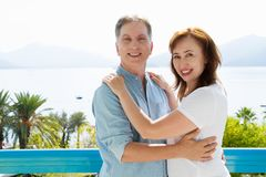 Summer family vacation. Happy middle aged couple having fun on travel holidays weekend. Sea and beach background. Copy space. Selective focus royalty free stock photos