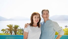 Summer family vacation. Happy middle aged couple having fun on travel holidays weekend. Sea and beach background. Copy space.  royalty free stock photos