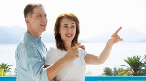 Summer family vacation. Happy middle aged couple having fun on travel holidays weekend. Sea and beach background. Copy space. Selective focus. Banner royalty free stock photo