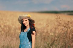 Summer Farm Girl with Straw Hat in Nature royalty free stock photos