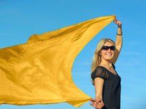 Summer fashion. A young blond woman with a yellow scarf Stock Photography