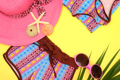 Summer Fashion. Summer fashion: Clothing and accessories for beach on yellow background Royalty Free Stock Images