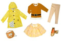 Summer fashion. Collage set of baby child girl clothes isolated on a white background. T-shirts, skirts, shoes or sneaker and rain. Jacket stock image