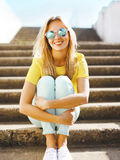 Summer and fashion concept - portrait pretty fun blonde girl in Stock Photo
