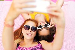 Teenage girls in sunglasses taking selfie Royalty Free Stock Photo
