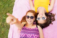 Teenage girls in sunglasses on picnic blanket Stock Photography