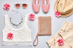 Summer Fashion girl clothes set. Street style. Street style. Summer Fashion girl clothes set, accessories. Trendy sunglasses, gumshoes, lace top, handbag clutch stock photos