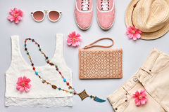 Summer Fashion girl clothes stylish set. Overhead. Summer Fashion girl clothes set, accessories. Trendy sunglasses, gumshoes, lace top, handbag clutch, necklace royalty free stock image