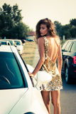 Summer fashion girl in golden dress stock photography