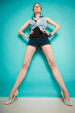 Summer fashion girl in jeans shirt shorts and high heels. Royalty Free Stock Images