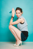 Summer fashion girl in jeans shirt shorts and high heels. Stock Photography
