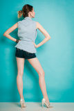 Summer fashion girl in jeans shirt shorts and high heels. Royalty Free Stock Photography