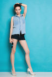 Summer fashion. Girl in jeans shirt and shorts. Stock Image