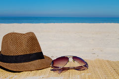 Summer fashion hat and sunglasses on a beach Stock Photo