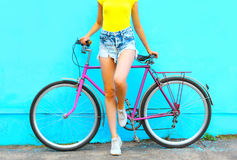 Summer fashion look, pretty woman with bicycle posing royalty free stock photography