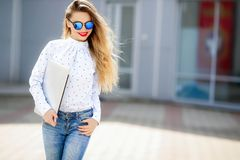 Summer, fashion and people concept - bright stylish portrait pretty woman in sunglasses against colorful wall in the. City, street fashion stock photo