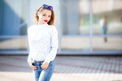 Summer, fashion and people concept - bright stylish portrait pretty woman in sunglasses against colorful wall in the. City, street fashion royalty free stock photos