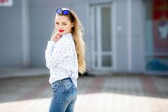 Summer, fashion and people concept - bright stylish portrait pretty woman in sunglasses against colorful wall in the. City, street fashion stock images