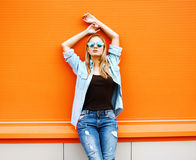 Summer, fashion and people concept - bright stylish pretty blond Stock Photos
