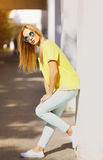 Summer, fashion and people concept - bright stylish pretty girl Stock Photography