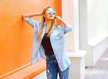 Summer, fashion and people concept - bright stylish pretty woman Stock Photography