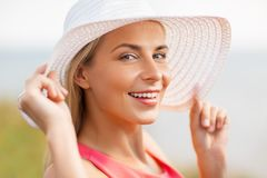 Portrait of beautiful smiling woman in sun hat Stock Image
