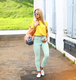 Summer, fashion and people concept - stylish pretty hipster woman in sunglasses outdoors in city stock image
