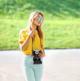 Summer, fashion and people concept - stylish pretty modern girl Royalty Free Stock Image