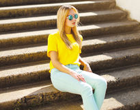 Summer, fashion and people concept - stylish pretty woman. In sunglasses posing in the city, street fashion royalty free stock images