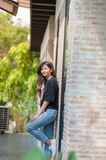 Summer, fashion and people concept - young woman posing outdoor. Over brick wall,street fashion Royalty Free Stock Images
