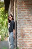 Summer, fashion and people concept - young woman posing outdoor. Over brick wall,street fashion Royalty Free Stock Photography