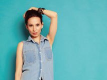 Summer fashion. Portrait of girl in jeans shirt. Stock Image