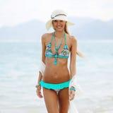 Summer fashion portrait of pretty young woman in bikini pos Royalty Free Stock Photos