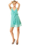 Summer fashion. Pretty fashionable girl in green dress Stock Photo