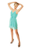 Summer fashion. Pretty fashionable girl in green dress Royalty Free Stock Photos
