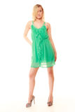 Summer fashion. Pretty fashionable girl in green dress Stock Photos