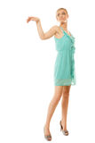 Summer fashion. Pretty fashionable girl in green dress Royalty Free Stock Image