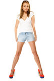 Summer fashion. Pretty sexy girl in denim shorts Stock Image